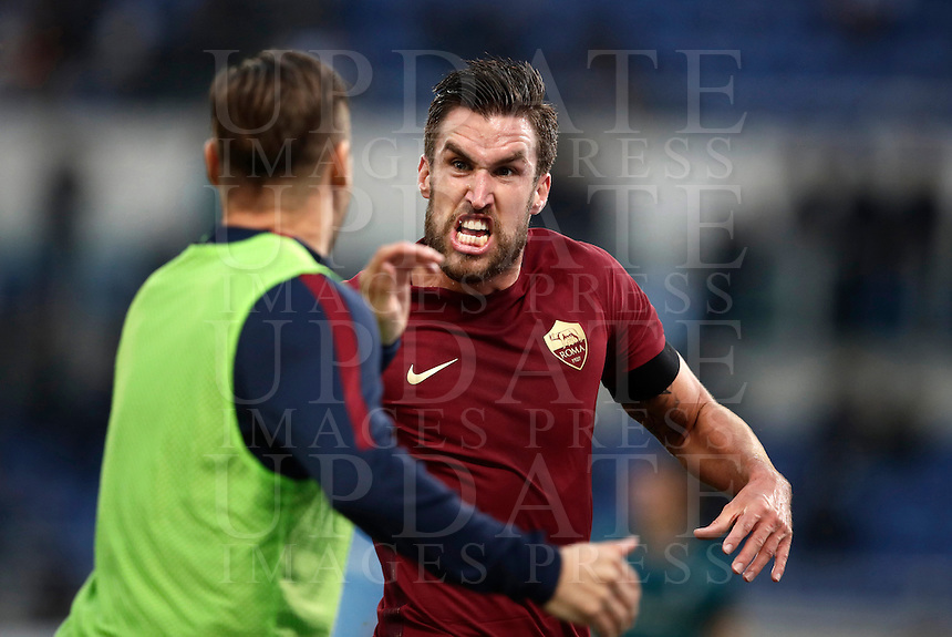 Calcio, Serie A: Lazio vs Roma. Roma, stadio Olimpico, 4 dicembre 2016.<br /> Roma's Kevin Strootman, right, celebrates with teammate Francesco Totti after scoring during the Italian Serie A football match between Lazio and Rome at Rome's Olympic stadium, 4 December 2016. Roma won 2-0.<br /> UPDATE IMAGES PRESS/Isabella Bonotto