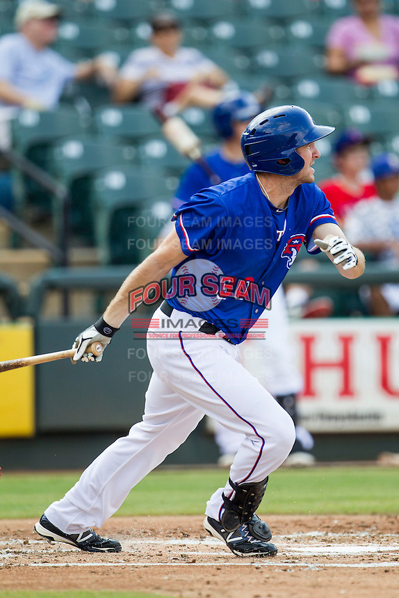 Round Rock Express outfielder Jared Hoying (30) follows through on his swing during the first game of a Pacific Coast League doubleheader against the Memphis Redbirds on August 3, 2014 at the Dell Diamond in Round Rock, Texas. The Redbirds defeated the Express 4-0. (Andrew Woolley/Four Seam Images)