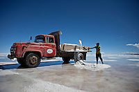 """Uyuni Salt Flats, Bolivia<br /> April 19, 2012<br /> A view of man loading a truck with salt in the Uyuni Salt Flats, the largest salt desert in the world and one of the main attractions for the Dakar 2014 next January.  ©PATRICIO CROOKER/ARCHIVO LATINO For  the first time in its history,  in January 2014 the Dakar Rally will  be cross part of Bolivia, one of the wildest South American nations.  """"The organizers of the Dakar, attracted by the discovery of new spaces, were conquered by Bolivian landscapes that can be classified among the most striking of the continent,"""" says the official site of the international race.<br /> The most impressive is the section that runs through the Salar of Uyuni,  considered the world's largest salt flat and a place of surreal beauty, almost otherworldly.<br /> The competition is scheduled for  in January 2014. Our photographer and  friend Patricio Crooker  show us  the unique beauty of the places the rally will hit."""
