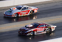 Sept. 14, 2012; Concord, NC, USA: NHRA pro stock driver Greg Anderson (near lane) races alongside Mike Edwards during qualifying for the O'Reilly Auto Parts Nationals at zMax Dragway. Mandatory Credit: Mark J. Rebilas-
