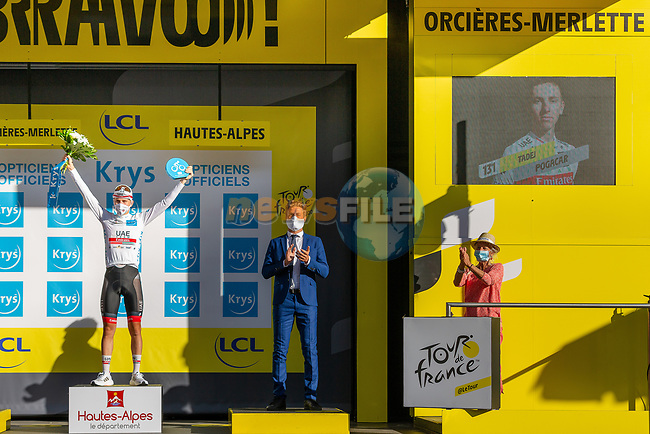Tadej Pogacar (SLO) takes over the young riders White Jersey at the end of Stage 4 of Tour de France 2020, running 160.5km from Sisteron to Orcieres-Merlette, France. 1st September 2020.<br /> Picture: ASO/Herve Tarrieu | Cyclefile<br /> All photos usage must carry mandatory copyright credit (© Cyclefile | ASO/Herve Tarrieu)