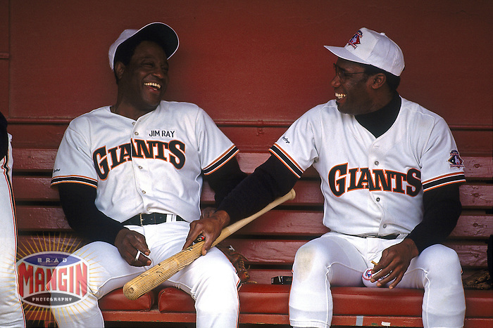 SAN FRANCISCO, CA - Jim Ray Hart and Bobby Bonds of the San Francisco Giants smoke cigarettes in the dugout before an old timers day game at Candlestick Park in San Francisco, California in 1992. Photo by Brad Mangin