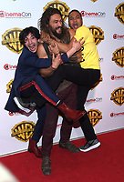 Ezra Miller + Jason Momoa + Ray Fisher @ the photocall for WB films presentation held @ The Colosseum at Caesars Palace.<br /> March 29, 2017 , Las Vegas, USA. # CINEMA CON 2017 - PHOTOCALL WB STUDIOS
