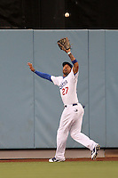 Los Angeles Dodgers center fielder Matt Kemp #27 catches a fly ball against the San Diego Padres at Dodger Stadium on August 30, 2011 in Los Angeles,California. Los Angeles defeated San Diego 8-5.(Larry Goren/Four Seam Images)