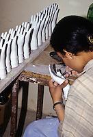 Ceramics, Nabeul, Tunisia.  Woman Painting Ceramic Hands of Fatima.  Le Caravane Workshop.