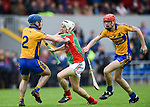 Noel Purcell and Paidi Fitzpatrick of Sixmilebridge in action against Ryan Taylor of  Clooney-Quin during their senior county final at Cusack Park. Photograph by John Kelly.