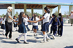 SCHOOL TEACHER AND CHILDREN PLAY 'RING AROUND the ROSIE""