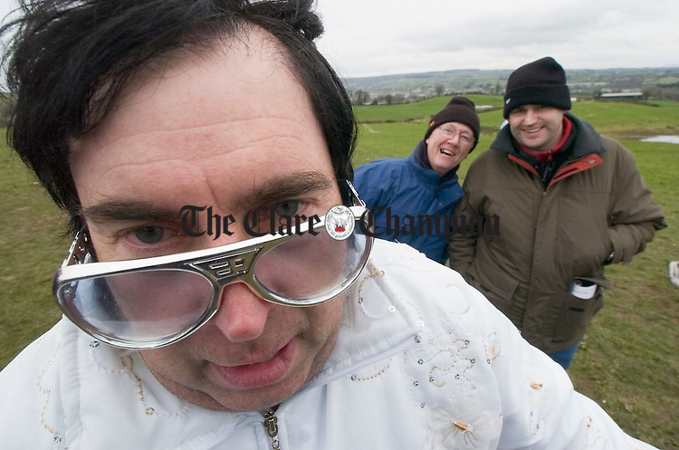 The king himself Myles Cavanagh or Elvis to his friends serenades the camera to the amusement of PJ Counihan and Conor Daly at the Killaloe Point to Point in Garranboy. Photograph by John Kelly.