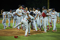 Cristhian Longa (39) and Malcom Nunez (54) of the Johnson City Cardinals hug after winning the 2019 Appalachian League Championship against the Burlington Royals at Burlington Athletic Stadium on September 4, 2019 in Burlington, North Carolina. The Cardinals defeated the Royals 8-6 to win the 2019 Appalachian League Championship. (Brian Westerholt/Four Seam Images)