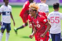 ORLANDO, FL - APRIL 24: Luke Singh #26 of Toronto FC celebrates his goal during a game between Vancouver Whitecaps and Toronto FC at Exploria Stadium on April 24, 2021 in Orlando, Florida.