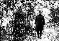 Sergt. Alvin C. York, 328th Infantry, who with aid of 17 men, captured 132 German prisoners; shows hill on which raid took place (October 8, 1918).  Argonne Forest, near Cornay, France.  February 7, 1919.  Pfc. F.C. Phillips.  (Army)<br />NARA FILE #:  111-SC-49191<br />WAR & CONFLICT BOOK #:  498