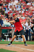 Miles Teller bats during the All-Star Legends and Celebrity Softball Game on July 12, 2015 at Great American Ball Park in Cincinnati, Ohio.  (Mike Janes/Four Seam Images)