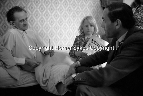 """""""Thorpe works for us."""" Jeremy Thorpe on the election campaign trail mid Devon constituency 1979 . Visiting sick constituent. This man is in a day bed and is unwell, daughter has a Thorpe works for us flyer."""