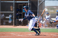 AZL Padres 1 first baseman Greg Lambert (14) follows through on his swing during an Arizona League game against the AZL Royals at Peoria Sports Complex on July 4, 2018 in Peoria, Arizona. The AZL Royals defeated the AZL Padres 1 5-4. (Zachary Lucy/Four Seam Images)