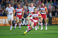 20120803 Copyright onEdition 2012©.Free for editorial use image, please credit: onEdition..Dan Robson of Gloucester Rugby acclerates upfield against Gloucester Rugby 7s at The Recreation Ground, Bath in the Final round of The J.P. Morgan Asset Management Premiership Rugby 7s Series...The J.P. Morgan Asset Management Premiership Rugby 7s Series kicked off again for the third season on Friday 13th July at The Stoop, Twickenham with Pool B being played at Edgeley Park, Stockport on Friday, 20th July, Pool C at Kingsholm Gloucester on Thursday, 26th July and the Final being played at The Recreation Ground, Bath on Friday 3rd August. The innovative tournament, which involves all 12 Premiership Rugby clubs, offers a fantastic platform for some of the country's finest young athletes to be exposed to the excitement, pressures and skills required to compete at an elite level...The 12 Premiership Rugby clubs are divided into three groups for the tournament, with the winner and runner up of each regional event going through to the Final. There are six games each evening, with each match consisting of two 7 minute halves with a 2 minute break at half time...For additional images please go to: http://www.w-w-i.com/jp_morgan_premiership_sevens/..For press contacts contact: Beth Begg at brandRapport on D: +44 (0)20 7932 5813 M: +44 (0)7900 88231 E: BBegg@brand-rapport.com..If you require a higher resolution image or you have any other onEdition photographic enquiries, please contact onEdition on 0845 900 2 900 or email info@onEdition.com.This image is copyright the onEdition 2012©..This image has been supplied by onEdition and must be credited onEdition. The author is asserting his full Moral rights in relation to the publication of this image. Rights for onward transmission of any image or file is not granted or implied. Changing or deleting Copyright information is illegal as specified in the Copyright, Design and Patents Act 1988. If you are in any way unsure of your right to p