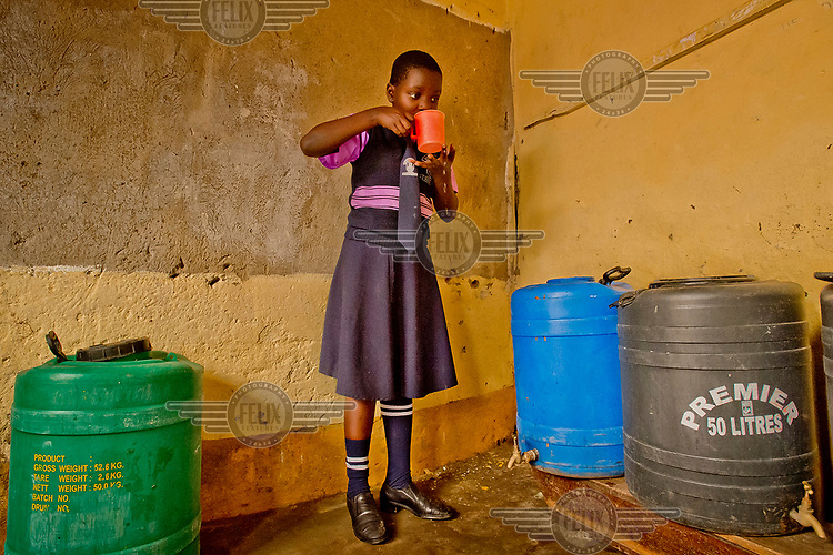 A student at the Special Care Junior School, in the district of Kanyanya, drinks water produced by the school's Solvatten solar water purifier with water. The school purchased the device to be able to offer their pupils potable drinking water.