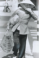 1972 FILE PHOTO - <br /> <br /> Old woman carries bundles; For her; old traditions haven't died
