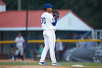 Burlington Royals relief pitcher Angel Zerpa (30) looks to his catcher for the sign against the Danville Braves at Burlington Athletic Stadium on July 13, 2019 in Burlington, North Carolina. The Royals defeated the Braves 5-2. (Brian Westerholt/Four Seam Images)