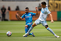 LOS ANGELES, CA - MAY 29: Maximiliano Moralez #10 of NYCFC meets with Eduard Atuesta #20 of LAFC during a game between New York City FC and Los Angeles FC at Banc of California Stadium on May 29, 2021 in Los Angeles, California.