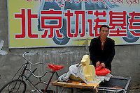 A vendor selling the famous Tibetan Butter on the street of Lhasa