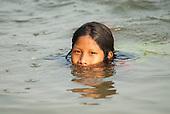 Aldeia Baú, Para State, Brazil. Kokodju Kayapo swimming in the river.