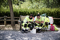 2 local community workers waiting for the riders to pass by while checking the race on their phone<br /> <br /> Stage 5 from Gap to Privas (183km)<br /> <br /> 107th Tour de France 2020 (2.UWT)<br /> (the 'postponed edition' held in september)<br /> <br /> ©kramon
