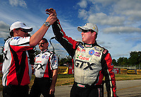 Sept. 5, 2011; Claremont, IN, USA: NHRA funny car driver Mike Neff celebrates with his crew after winning the US Nationals at Lucas Oil Raceway. Mandatory Credit: Mark J. Rebilas-