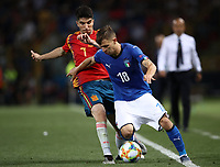Football:  Uefa European under 21 Championship 2019, Italy - Spain Renato Dall'Ara stadium Bologna Italy on June16, 2019.<br /> Italy's Nicolò Barella (r) in action with Carlos Soler (l) during the  Uefa European under 21 Championship 2019 Football match between Italy and Spain at Renato Dall'Ara stadium in Bologna, Italy on June16, 2019.<br /> UPDATE IMAGES PRESS/Isabella Bonotto