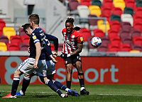 17th April 2021; Brentford Community Stadium, London, England; English Football League Championship Football, Brentford FC versus Millwall; Ivan Toney of Brentford crosses the ball past Jake Cooper of Millwall