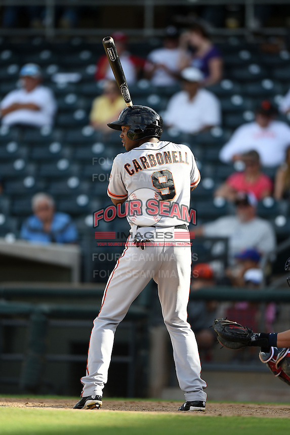 Scottsdale Scorpions outfielder Daniel Carbonell (9) during an Arizona Fall League game against the Peoria Javelinas on October 18, 2014 at Surprise Stadium in Surprise, Arizona.  Peoria defeated Scottsdale 4-3.  (Mike Janes/Four Seam Images)