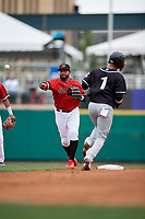 Rochester Red Wings second baseman Jordany Valdespin (23) throws to first base as Ryan Goins (1) avoids the throw during an International League game against the Charlotte Knights on June 16, 2019 at Frontier Field in Rochester, New York.  Rochester defeated Charlotte 11-5 in the first game of a doubleheader that was a continuation of a game postponed the day prior due to inclement weather.  (Mike Janes/Four Seam Images)