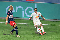 FOXBOROUGH, MA - MAY 22: Kyle Duncan #6 of New York Red Bulls crosses the ball as Teal Bunbury #10 of New England Revolution closes during a game between New York Red Bulls and New England Revolution at Gillette Stadium on May 22, 2021 in Foxborough, Massachusetts.