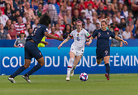 PARIS,  - JUNE 28: Wendie Renard #3 defends Rose Lavelle #16 as she moves past Eugénie Le Sommer #9 during a game between France and USWNT at Parc des Princes on June 28, 2019 in Paris, France.