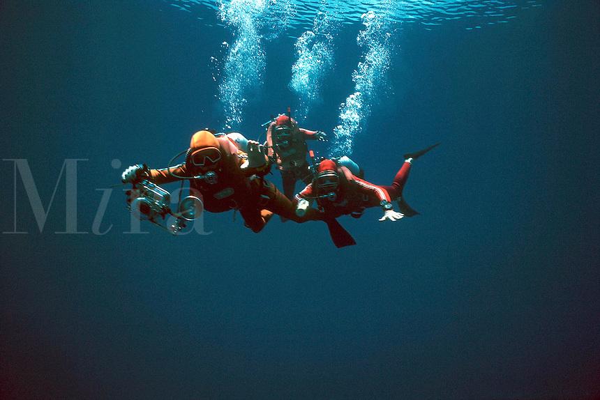 .3 scuba divers in the deep ocean. MR