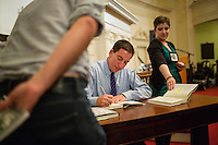 Glenn Greenwald signs copies of his recently released book, No Place to Hide: Edward Snowden, the NSA, and the U.S. Surveillance State, after speaking to an audience at the First Parish Church in Harvard Square for a Harvard Book Store author event with Noam Chomsky in Cambridge, Massachusetts, USA. Greenwald is a lawyer, blogger, writer, and journalist, known most recently for his role in the Snowden NSA leaks. Greenwald recently received a Polk Award for National Security Reporting, and the 2014 Pulitzer Prize for Public Service.