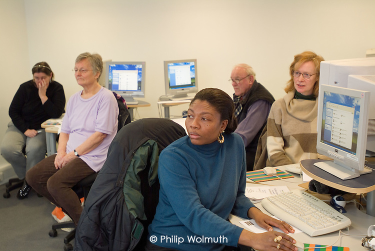 Digital photography class at the First Step project, based at Lisson Green Estate Community Centre, Paddington, London