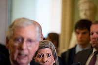 United States Senator Joni Ernst (Republican of Iowa) listens while United States Senate Minority Leader Mitch McConnell (Republican of Kentucky) offers remarks following the Republican Senate luncheon at the US Capitol in Washington, DC, Tuesday, July 20, 2021. Credit: Rod Lamkey / CNP /MediaPunch