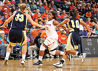 Nov. 14, 2010; Charlottesville, VA, USA; Mount St. Mary's forward Tara Lonergan (33) and Mount St. Mary's guard Selina Mann (10) defend Virginia guard Paulisha Kellum (3) during the game at the John Paul Jones Arena. Virginia won 81-58. Mandatory Credit: Andrew Shurtleff
