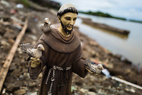 A statue of Saint Francis of Assisi, the patron saint of the town, is seen on the Atrato river shore during the San Pacho festival in Quibdó, Colombia, 3 October 2019. Every year at the turn of September and October, the capital of the Pacific region of Chocó holds the celebrations in honor of Saint Francis of Assisi (locally named as San Pacho), recognized as Intangible Cultural Heritage by UNESCO. Each day carnival groups, wearing bright colorful costumes and representing each neighborhood, dance throughout the city, supported by brass bands playing live music. The festival culminates in a traditional boat ride on the Atrato River, followed by massive religious processions, which accent the pillars of Afro-Colombian's identity – the Catholic devotion grown from African roots.