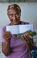 Trinidad Cuba woman with ration book for rations for food supplies in Cuba with very little food for people for one month welfare   13
