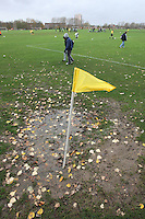 A corner flag is seen in a large puddle after heavy rain on football pitches at Hackney Marshes - 15/11/09 - MANDATORY CREDIT: Gavin Ellis/TGSPHOTO - Self billing applies where appropriate - Tel: 0845 094 6026