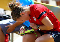WASHINGTON D.C. - September 02, 2013:<br /> Lauren Holiday inspects her boots During a USA WNT open practice at RFK Stadium, in Washington D.C. the day before the USA v Mexico international friendly match.