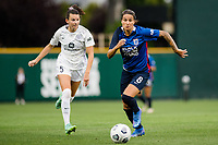 TACOMA, WA - JULY 31: Dzsenifer Marozsan #8 of the OL Reign dribbles the ball during a game between Racing Louisville FC and OL Reign at Cheney Stadium on July 31, 2021 in Tacoma, Washington.