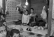 Children at work in a butcher shop.  Fez, Morocco - Child labor as seen around the world between 1979 and 1980 – Photographer Jean Pierre Laffont, touched by the suffering of child workers, chronicled their plight in 12 countries over the course of one year.  Laffont was awarded The World Press Award and Madeline Ross Award among many others for his work.