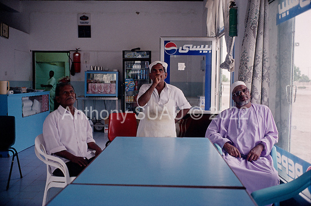 Salalah, Oman.July 2001..Watching a foot ball game in a small deli.