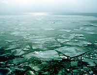 WI45A53 Ice floating on Lake Michigan in winter, Whitefish Dunes State Park, WI. Door County Wisconsin United States of America.
