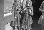 Niagara Falls New York:  Two children wearing rain gear on the Maid of the Mist.