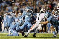 CHAPEL HILL, NC - NOVEMBER 02: Noah Ruggles #97 of the University of North Carolina kicks a field goal during a game between University of Virginia and University of North Carolina at Kenan Memorial Stadium on November 02, 2019 in Chapel Hill, North Carolina.