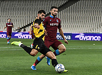 AEK's Nélson Oliveira (L) in action with  Trabzonspor's Huseyin Turkmen (R) during of the UEFA Europa League play-off, 1st leg, soccer match between AEK Athens FC and Trabzonspor at the OAKA Spyros Louis Stadium in Athens, Greece on August 22, 2019.
