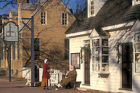 Colonial Williamsburg, Virginia, VA, Williamsburg, Interpreters wearing colonial costumes talk outside the village post office in Colonial Williamsburg.